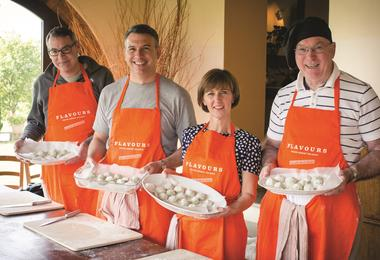 Guests cooking together on a Flavours Holidays trip