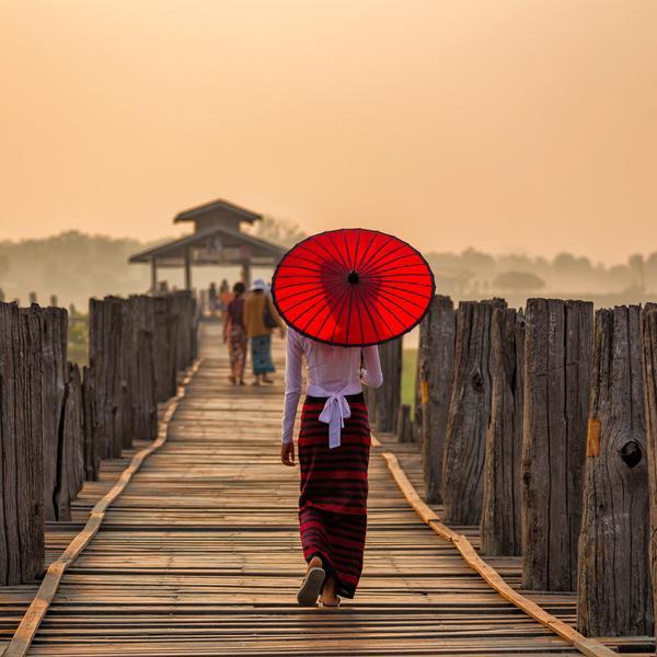 Girl with umbrella in Mandelay in Myanmar