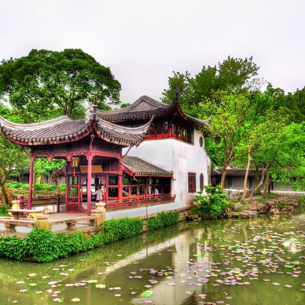 A view over a lily pond to the 12-century Humble Administrator's Garden