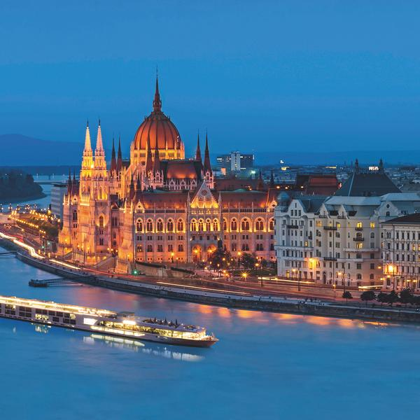 Scenic Amber sails past Budapest's parliament at dusk