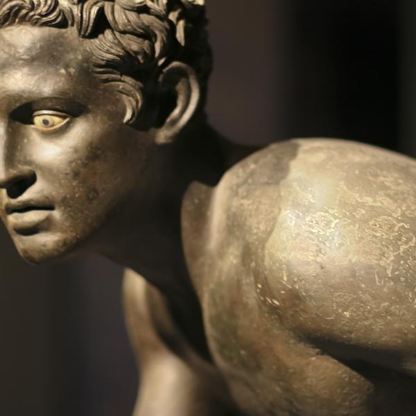 Roman bronze statue of a runner - Excavated at Herculaneum near Pompeii.
