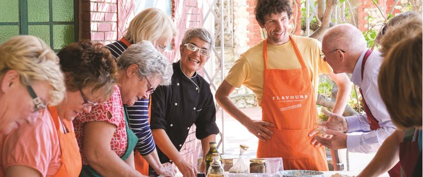 Guests preparing food on a Flavours Holiday