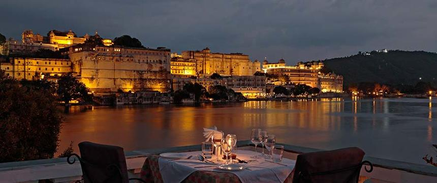 The beautiful view over Lake Pichola from Ambrai restaurant at sunset