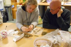 Laura Burnett Somerset FLO examining finds 1