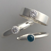 Sarah Macrae three single stone set rings