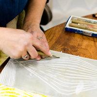 Sarah Burns cutting lino