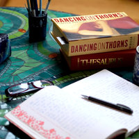 Books on table for crime writing course at West Dean College of Arts and Conservation