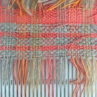 Rebecca Connolly Weaving on a body-tensioned loom