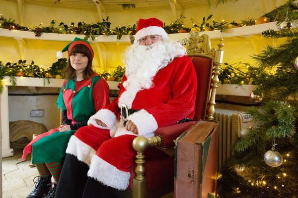 Father Christmas and his elf