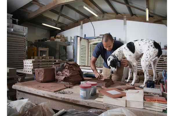 Tile maker, Richard Miller, in his studio, with friend