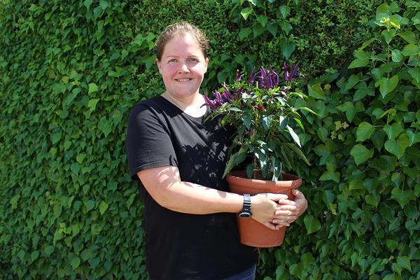 West Dean Gardens Laura Hughes holding chillies