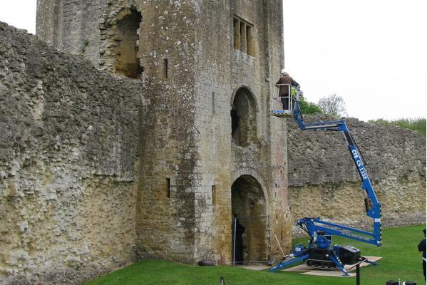 Cherry picker lift next to castle ruin Credit Graham Abrey