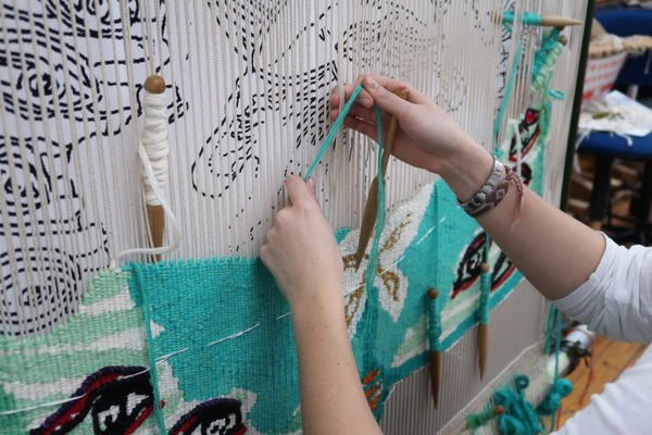 Emma Straw weaving 'The Empress of the Insects' at West Dean Tapestry Studio