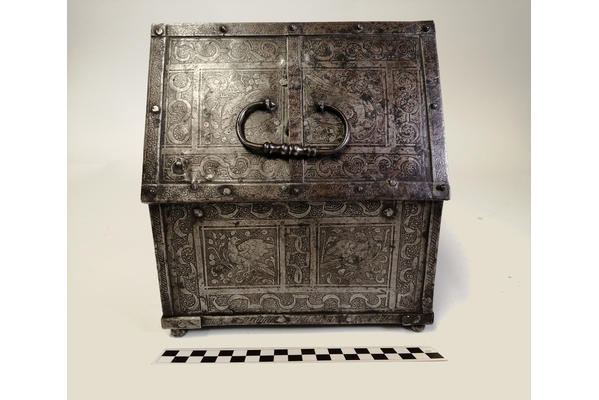 Fig 1 and 2. Iron casket prior to exposure to water. Showing the exterior and the locking mechanism in the lid.
