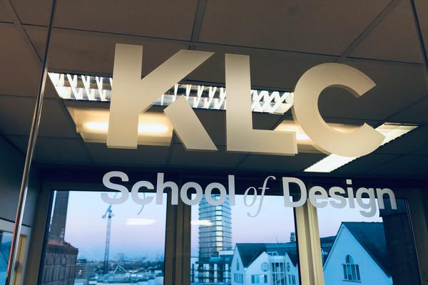 The KLC School of Design logo and London skyline reflected in a window.