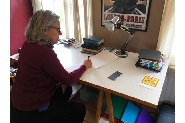 Jane is pictured at her writing desk.