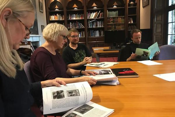 The Feminist and Queer Histories Reading Group meet in the library.