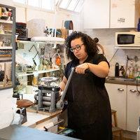 Ella McIntosh (pewtersmith) in studio. Image credit - Eden Photography