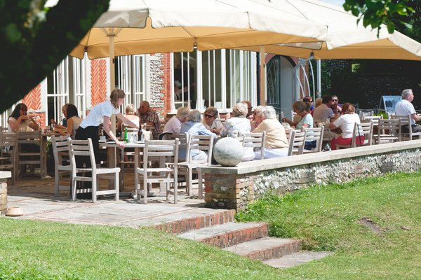 People enjoying lunch on the terrace at West Dean Gardens near Chichester