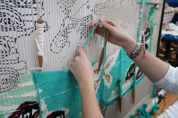 Emma Straw Fine Art student, weaving a tapestry at West Dean College