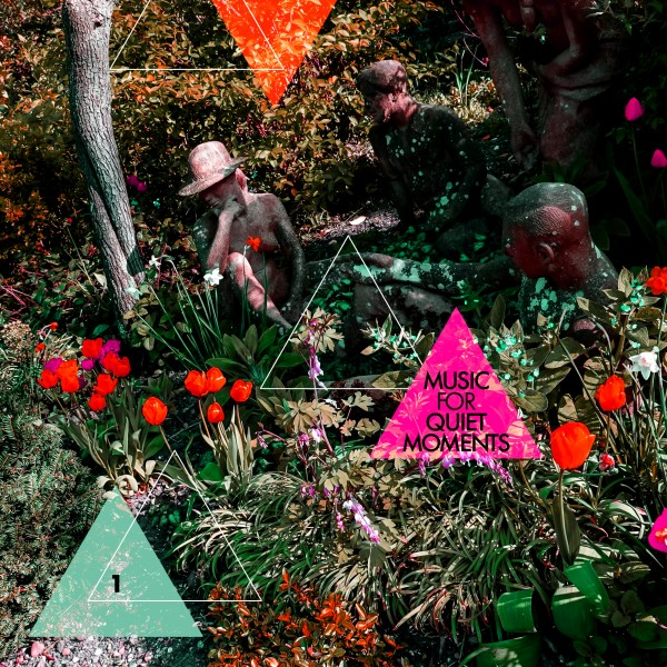 "Album cover for Robert Fripp's ""Music For Quiet Moments 1"". Features a gardenscape with two statues and red tulips."
