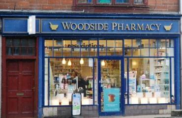 Woodside Pharmacy  logo